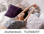 young woman stretching arms... | Shutterstock . vector #712568257