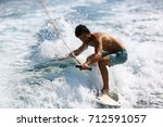 young man surfing on the wave. | Shutterstock . vector #712591057