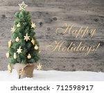 golden decorated christmas tree ... | Shutterstock . vector #712598917