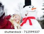 adorable little girl building a ... | Shutterstock . vector #712599337