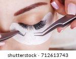 eyelash extension procedure.... | Shutterstock . vector #712613743