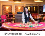 cute lady casino dealer at... | Shutterstock . vector #712636147
