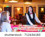 cute lady casino dealer at... | Shutterstock . vector #712636183