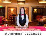 cute lady casino dealer at... | Shutterstock . vector #712636393