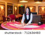 cute lady casino dealer at... | Shutterstock . vector #712636483