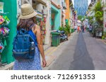 young asian woman traveler with ... | Shutterstock . vector #712691353