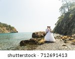 beautiful gorgeous bride and... | Shutterstock . vector #712691413