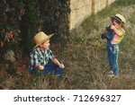 brother and sister on the walk. ... | Shutterstock . vector #712696327