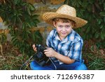 a little boy with an old camera ... | Shutterstock . vector #712696387