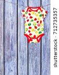 baby soft bodysuit hanging on...   Shutterstock . vector #712735357