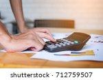 close up man hand using...   Shutterstock . vector #712759507