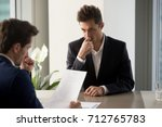 nervous male job candidate... | Shutterstock . vector #712765783