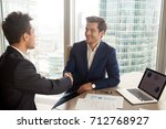 smiling ceo in stylish blue... | Shutterstock . vector #712768927