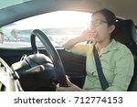 tired sleepy asian glasses girl ... | Shutterstock . vector #712774153