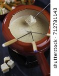 Small photo of Cheese fondue in red mag on a table top view