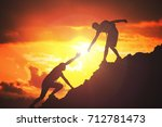 man is giving helping hand.... | Shutterstock . vector #712781473