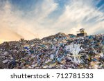 garbage pile in trash dump or... | Shutterstock . vector #712781533