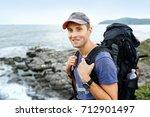 man traveler with backpack...   Shutterstock . vector #712901497