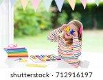 child doing homework for school ... | Shutterstock . vector #712916197
