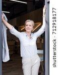 beautiful mature woman smiling...   Shutterstock . vector #712918177