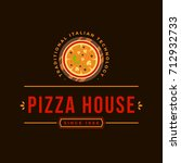 pizzeria vector emblem on... | Shutterstock .eps vector #712932733