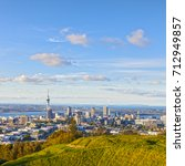 Small photo of Auckland, New Zealand, from the volcano Mount Eden, the crater rim is in the foreground.