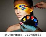 makeup artist applies colorful... | Shutterstock . vector #712980583