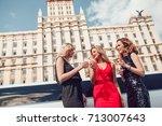 beautiful women near a... | Shutterstock . vector #713007643