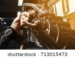 shirtless man flipping heavy...   Shutterstock . vector #713015473