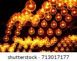 hanging round orange light lamp ... | Shutterstock . vector #713017177