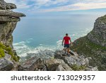 man on top of table mountain  ... | Shutterstock . vector #713029357