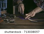 close up of man hand leather... | Shutterstock . vector #713038057