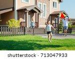 happy girl launching kite... | Shutterstock . vector #713047933