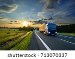 blue truck driving on the... | Shutterstock . vector #713070337