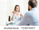 female doctor removes the cap... | Shutterstock . vector #713074357