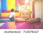 little girl in playground. girl ... | Shutterstock . vector #713078167