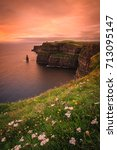 landscape of the irish coast at ... | Shutterstock . vector #713095147