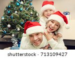 portrait of a young family.... | Shutterstock . vector #713109427