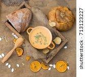 pumpkin soup and fresh bread. | Shutterstock . vector #713123227