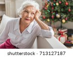 charming sad old woman is... | Shutterstock . vector #713127187