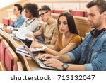 concentrated students studying... | Shutterstock . vector #713132047