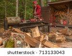 Older Man Using Log Splitter...