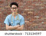 male doctor with his arms... | Shutterstock . vector #713134597