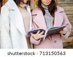 two beautiful girls read... | Shutterstock . vector #713150563