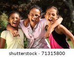 Hilarious laughter between three school girls - stock photo