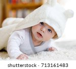 baby girl with blue eyes... | Shutterstock . vector #713161483