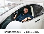 couple chooses the new car in... | Shutterstock . vector #713182507