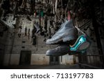 boots in chain dressing room in ... | Shutterstock . vector #713197783