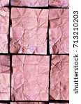 Small photo of close up of creased pink aluminum foil squares on black background, full frame, flat lay, vertical / Creased Pink Aluminum foil Squares on black Background, vertical