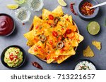 nachos chips with melted cheese ... | Shutterstock . vector #713221657